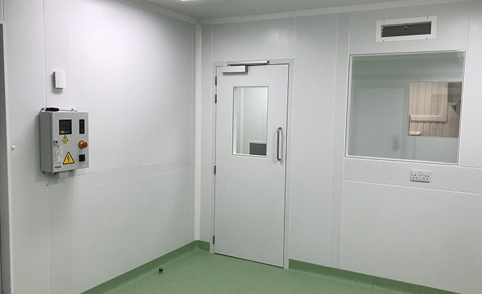 Cleanroom with integrated service raceway and flush door and window